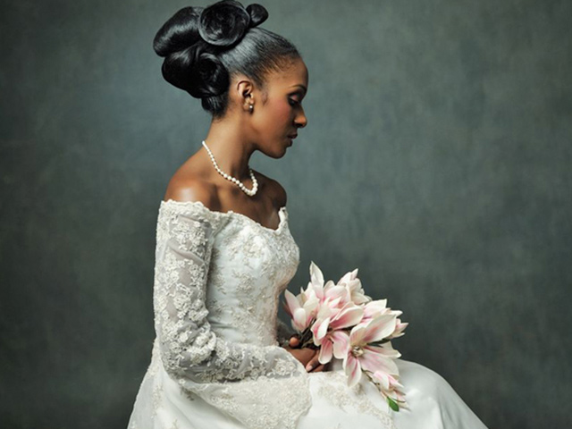 Junior Green seated bridal model with bouquet