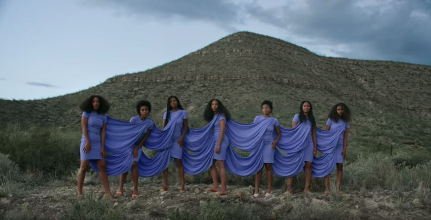 Solange and squad bound by lilac dresses