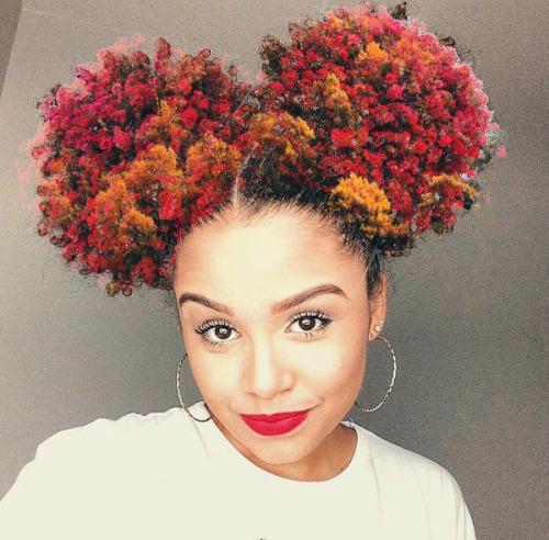 Artist paints the universe and nature into black women's hair